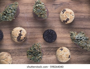 Background with cannabis nugs (forum cut cookies strain) over infused chocolate chips cookies - medical marijuana edibles concept
