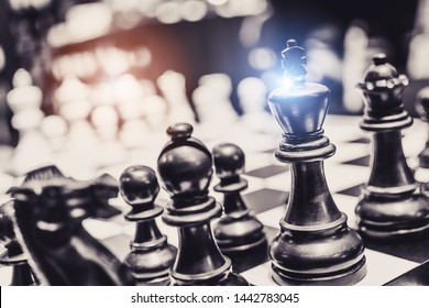 Background of chess game set with King, queen, pawn, knight, house pieces represent business completion thinking  strategy plan to successful win future innovation transformation with leadership