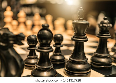 Background of chess game set with King, queen, pawn, knight, house pieces represent business completion thinking  strategy plan to win future innovation transformation with leadership