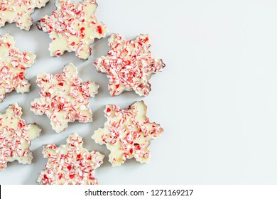 Background of chocolate peppermint bark snowflakes with copy space on right
