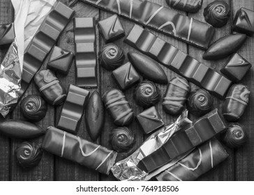 Background of chocolates, bars and sweets, free space for text, close up