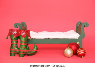 Background Christmas Holiday Elf Bed Prop Isolated On Red Backdrop