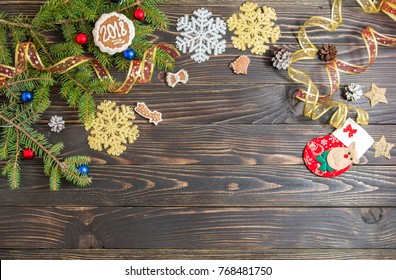 Background for Christmas menu. Cookie, fir and decoration on the old wooden table. Top view with copy space.