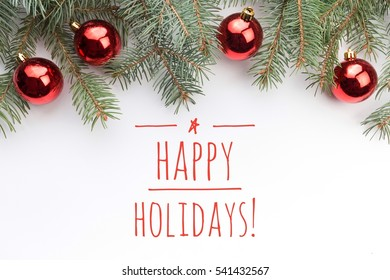 """Background with Christmas ornaments on white background and message """"HAPPY HOLIDAYS!"""""""