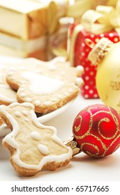 background of Christmas ornaments, sweets and a gift