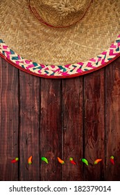 Background: Cinco De Mayo Celebration with Sombrero and Peppers