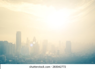 Background of cityscape concept: Blur aerial view building big city on amazing golden warm light at sunrise. Bangkok, Thailand, Asia