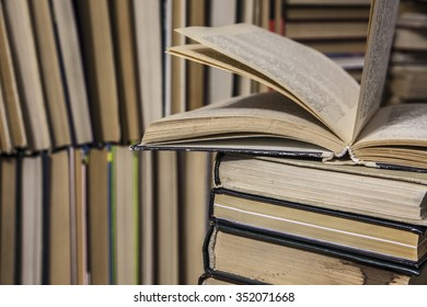 Background of Closed and Opened stack books lying on the bookshelf backdrop Idea of education, library in school and university
