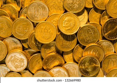 Background of a closeup stack  of golden coins