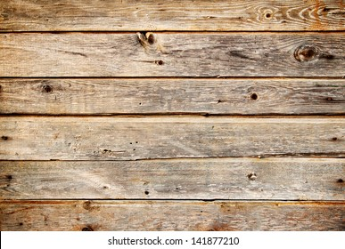 Background of coarse dark planks with knots
