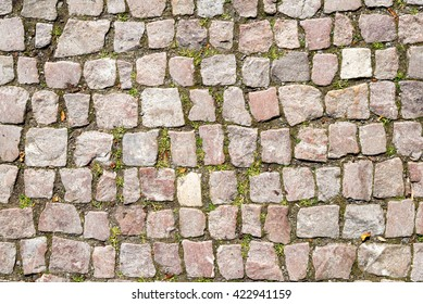 background of cobblestone with grass