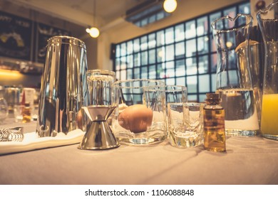 Background of cocktails mixing workshop preparation on counter bar. Professional bartender club preparing fresh delicious tasty cocktail alcohol liquor drink using beverage shaker on vintage concept