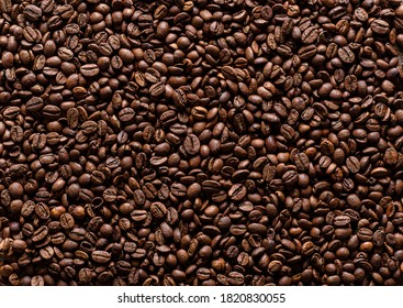 Background of coffee beans. Texture of brown roasted coffee beans.