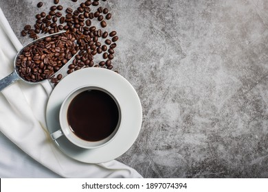 Background Coffee cup and beans on old kitchen table. Top view with copyspace for your text