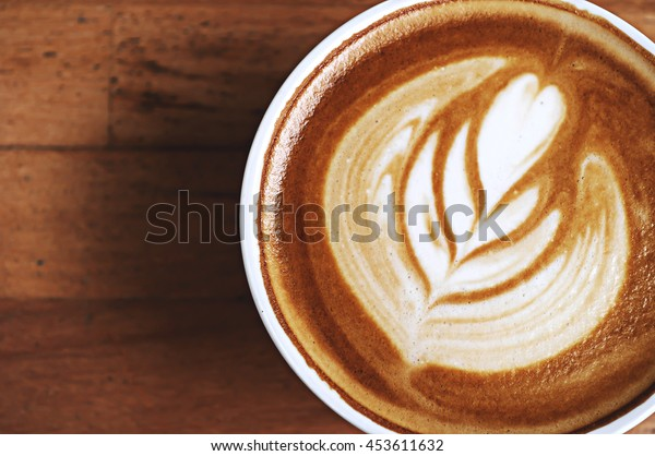 Background coffee in cup on wooden table.