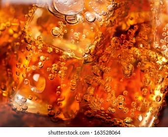 Background of cola with ice and bubbles