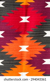 Background of colored Ecuadorian textile at the market of Otavalo in Ecuador, 2015.