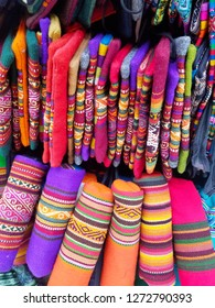Background of colored fabrics from a traditional ethnic market. Design fabrics.