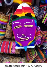 Background of colored fabrics and a traditional mask. Ethnic market. Design fabrics.