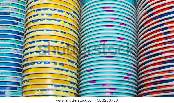 background of colored paper cups stacked