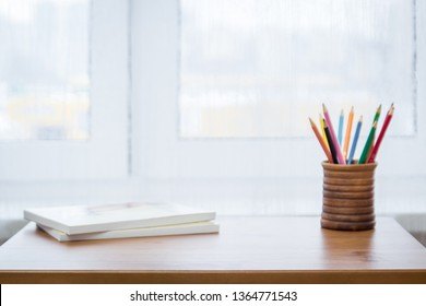 Background with colored pencils, notebooks and window