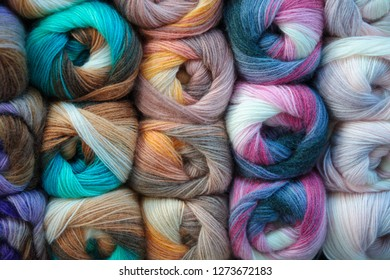 background of colored wool skein. yarn skein, colorful thread in skeins, Red yellow blue pink purple yarn collection