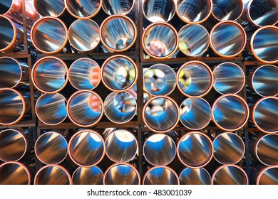 background of colorful big orange plastic pipes for hot water used at the building site close-up stack of pvc outside warehouse