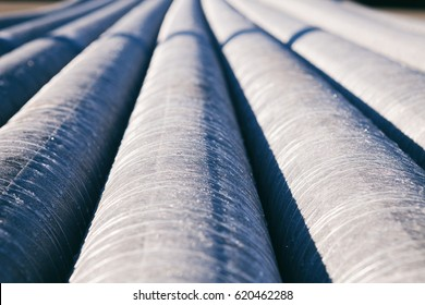 background of colorful big plastic pipes used at the building site close-up frontal view