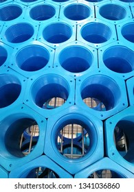 background of colorful Blue PVC pipes stacked in construction site