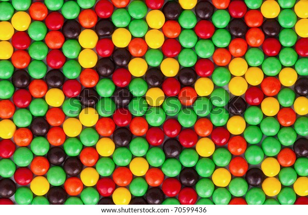 Background of colorful candies coated chocolate sweets