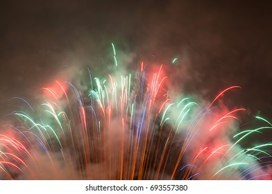 a background of colorful firework with a lot of smoke