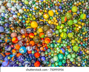 background of colorful Glass marbles of different sizes in a color pattern as metaphor for multicultural community coexistence