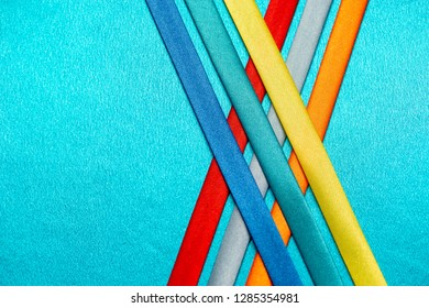 background with colorful ribbons on silk.