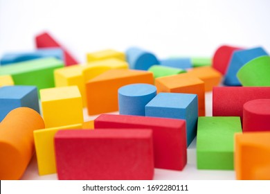 Background of colorful toy figures. Children's blocks on a white background