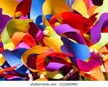 Background of colorful toy windmills/pinwheels