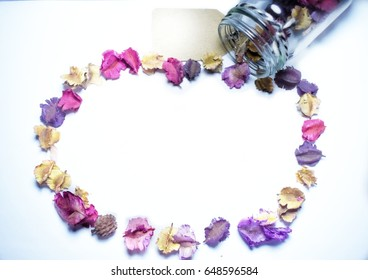 background with colourful dry flower and dry leaf out of the glass bottle