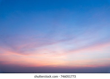 Background of colourful sunset sky on the beach,Dramatic sunset with twilight color sky and clouds.