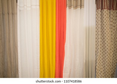 a background composed of different textures of curtains