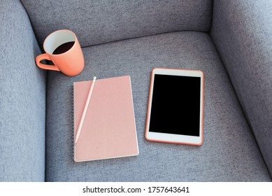 background concept. rose gold color object, diary and mockup tablet for ad banner text and coffee cup on chair sofa in morning   - Shutterstock ID 1757643641
