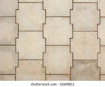 Background of concrete wall constructed from prefabricated cross shaped blocks