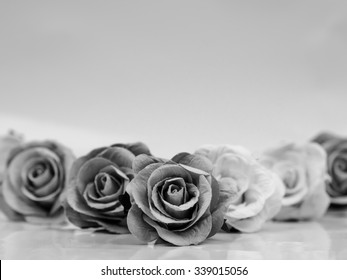 Background condolence with roses in black and white