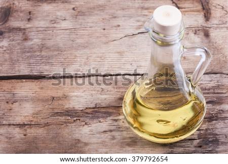 background cooking oil in bottle on wooden rustic table