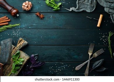 The background of cooking. On a black wooden background. Top view. Free space for your text.