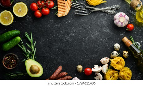 Background of cooking tagliatelle pasta and ingredients. Black stone background of Italian cuisine. Top view.