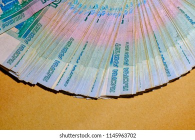 Background with copyspace of the new banknotes 1000 rubles as fan.