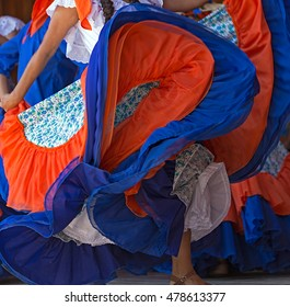 Background with a Costa Rican dancer's dress while dancing.