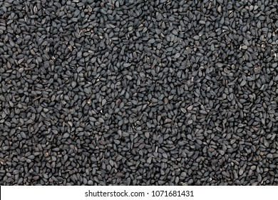 Background culinary texture of black seeds, nigella or kalonji a healthy Indian spice used in traditional medicine with a triangular shape and pungent flavor