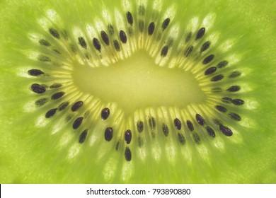 background with cut kiwi fruit macro