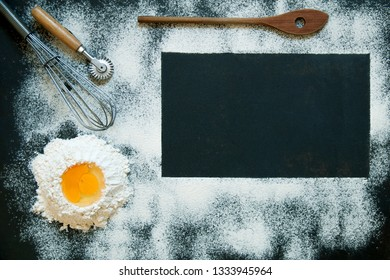 Background with dark rectangle for kitchen blog with flour, egg, pasta and cooking gear