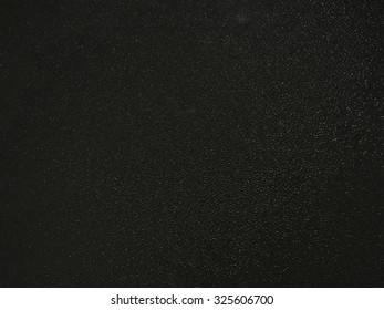Background of dark textured glass
